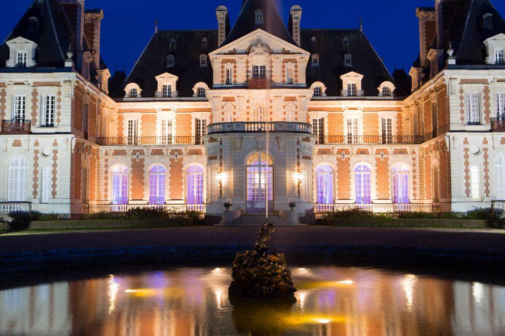chateau de baronville at night